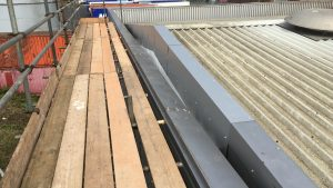 Storm Damage Roof Repairs to a Warehouse Roof in Rochester Kent 1