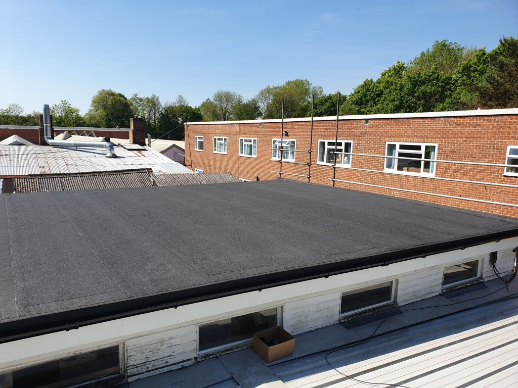 Flat roof felting over a workshop in Crawley, West Sussex