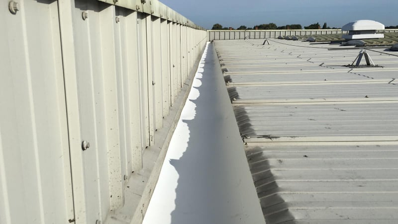 Guttering a factory and office roof in Sidcup, Kent