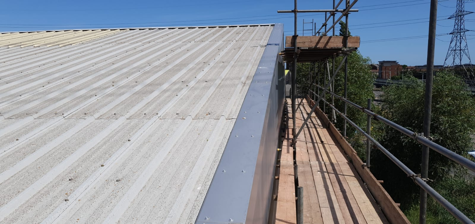 Repair work on the office section of a large Warehouse roof in Rainham, Essex