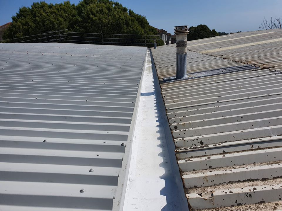 Over Roofing to an Industrial building in Littlehampton, West Sussex
