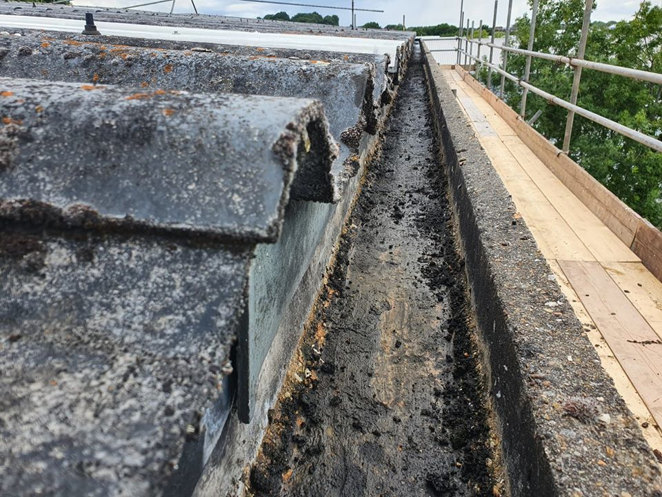 Gutter repair to warehouse and office roofs in Chessington Surrey