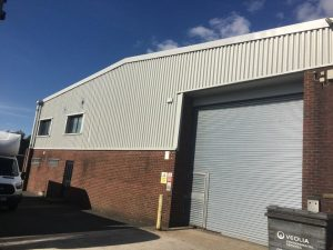 refurbishment work to the cladding of a warehouse Unit in Littlehampton West Sussex