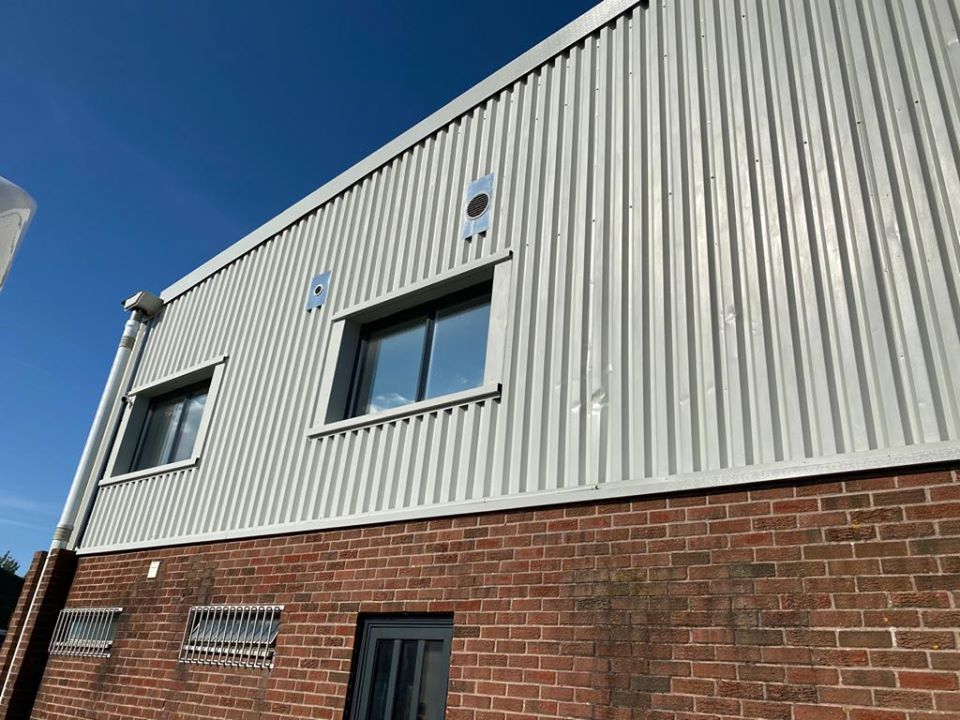 refurbishment work to the cladding of a warehouse Unit in Littlehampton, West Sussex