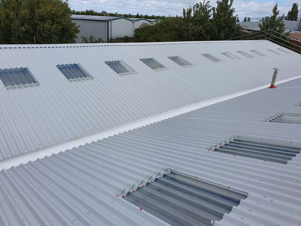 over-roofing to a warehouse roof in, Chichester, West Sussex
