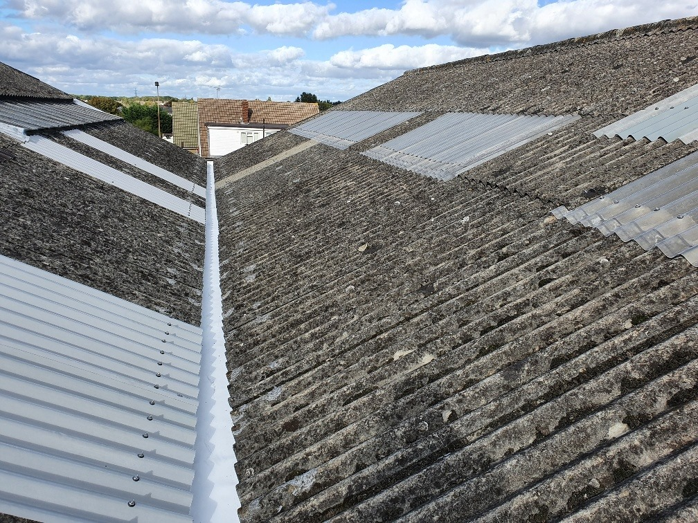 Gutter replacement to a warehouse roof in Benfleet Essex