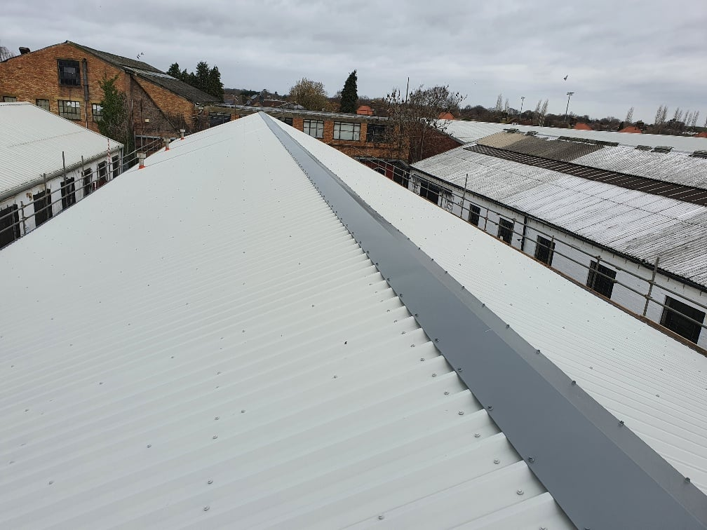 Factory over-roofing to an old roof in Hersham Surrey