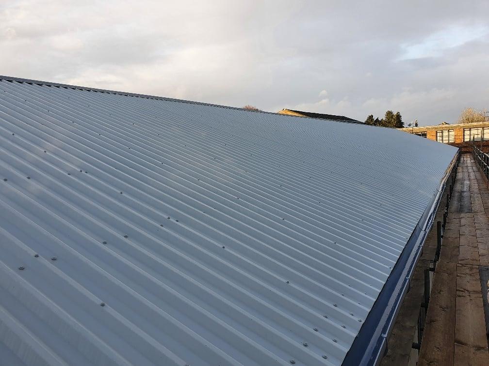 Over roofing to a factory roof in Hersham Surrey