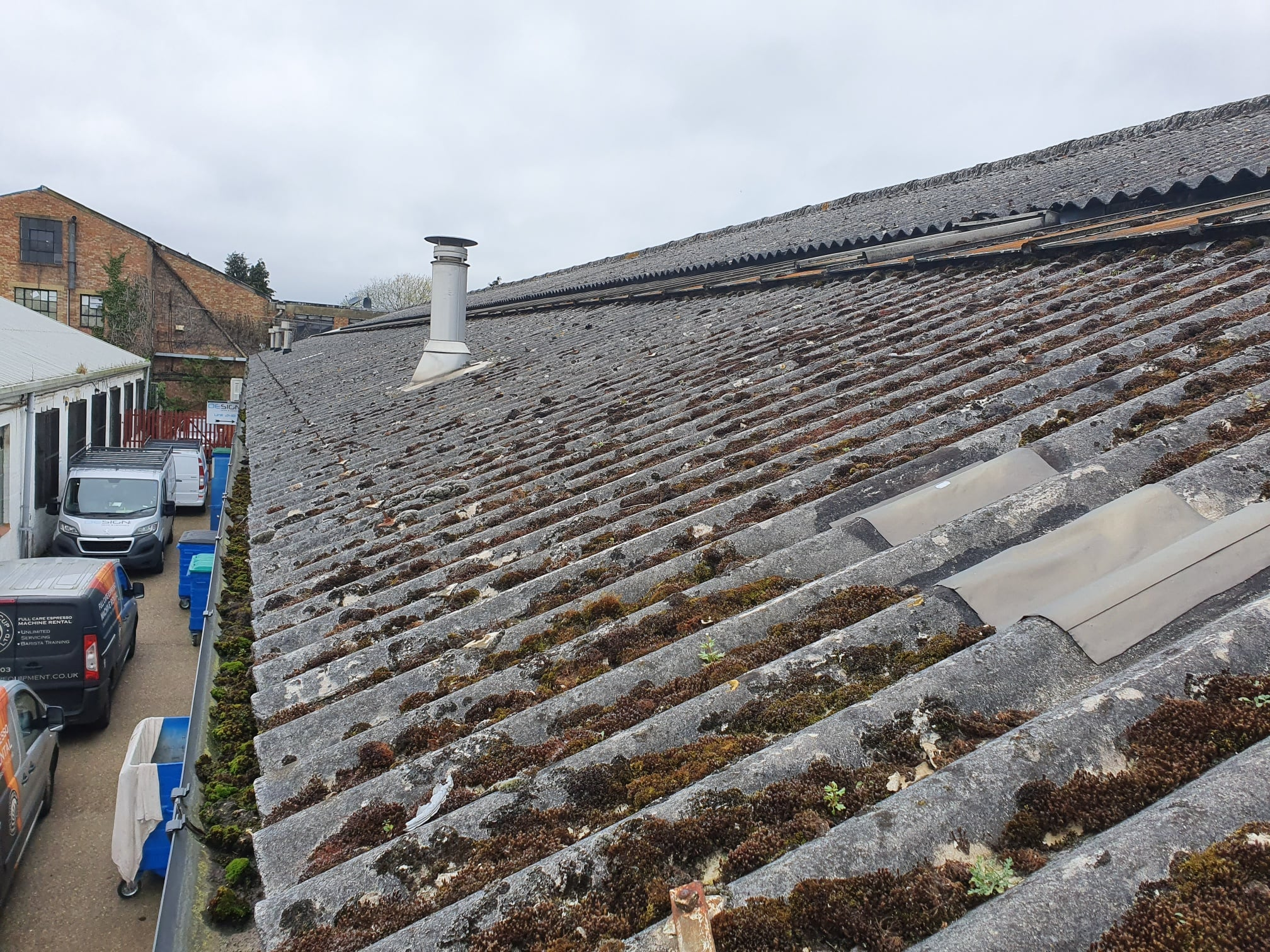 Over roofing to a warehouse roof in Hersham Surrey