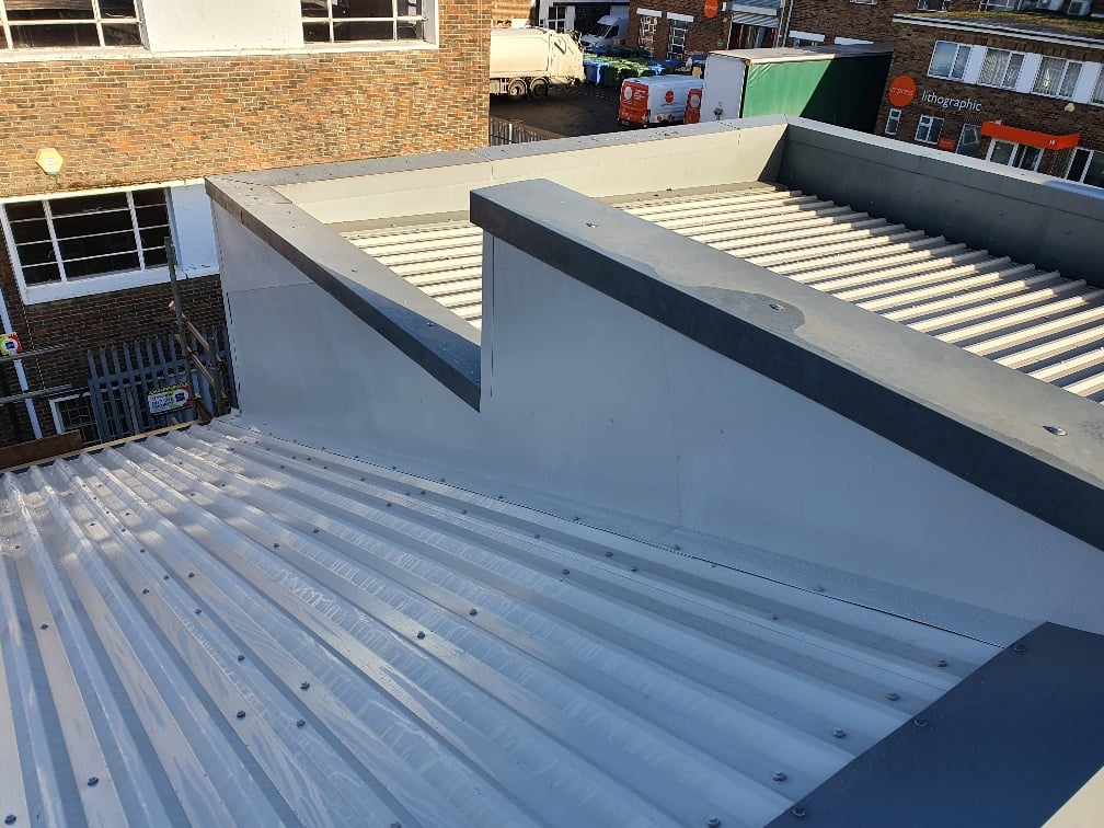 Warehouse over-roofing to an old roof in Hersham Surrey