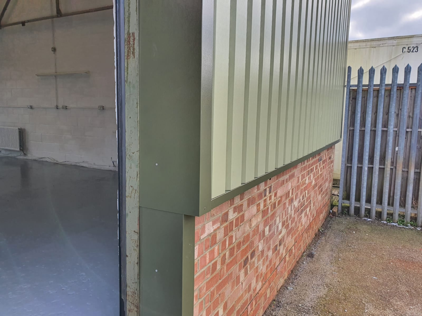 Vertical cladding repair to a warehouse in Burgess Hill West Sussex
