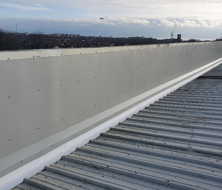 gutter repair on a warehouse and office roof in Hove West Sussex