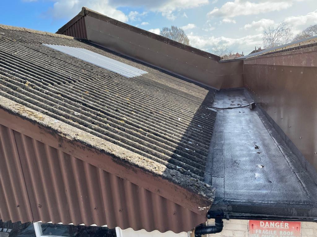 Gutter repair to a Warehouse roof in Benfleet Essex