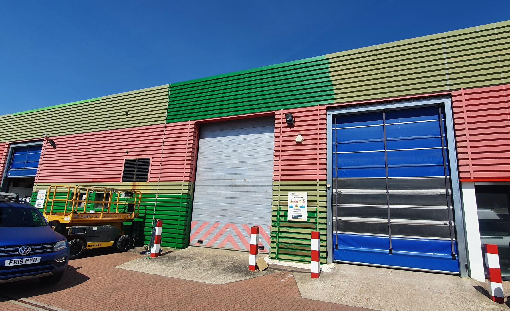 Cladding painting on a Factory warehouse in Worthing West Sussex