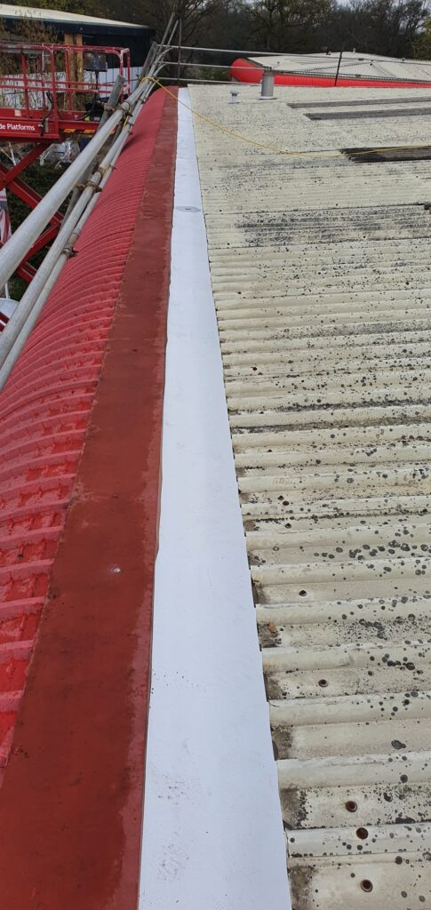 gutter lining work to a warehouse and office roof in Crawley