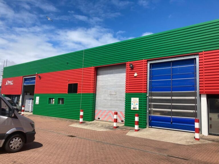 painting works to the cladding on a Factory warehouse in Worthing West Sussex