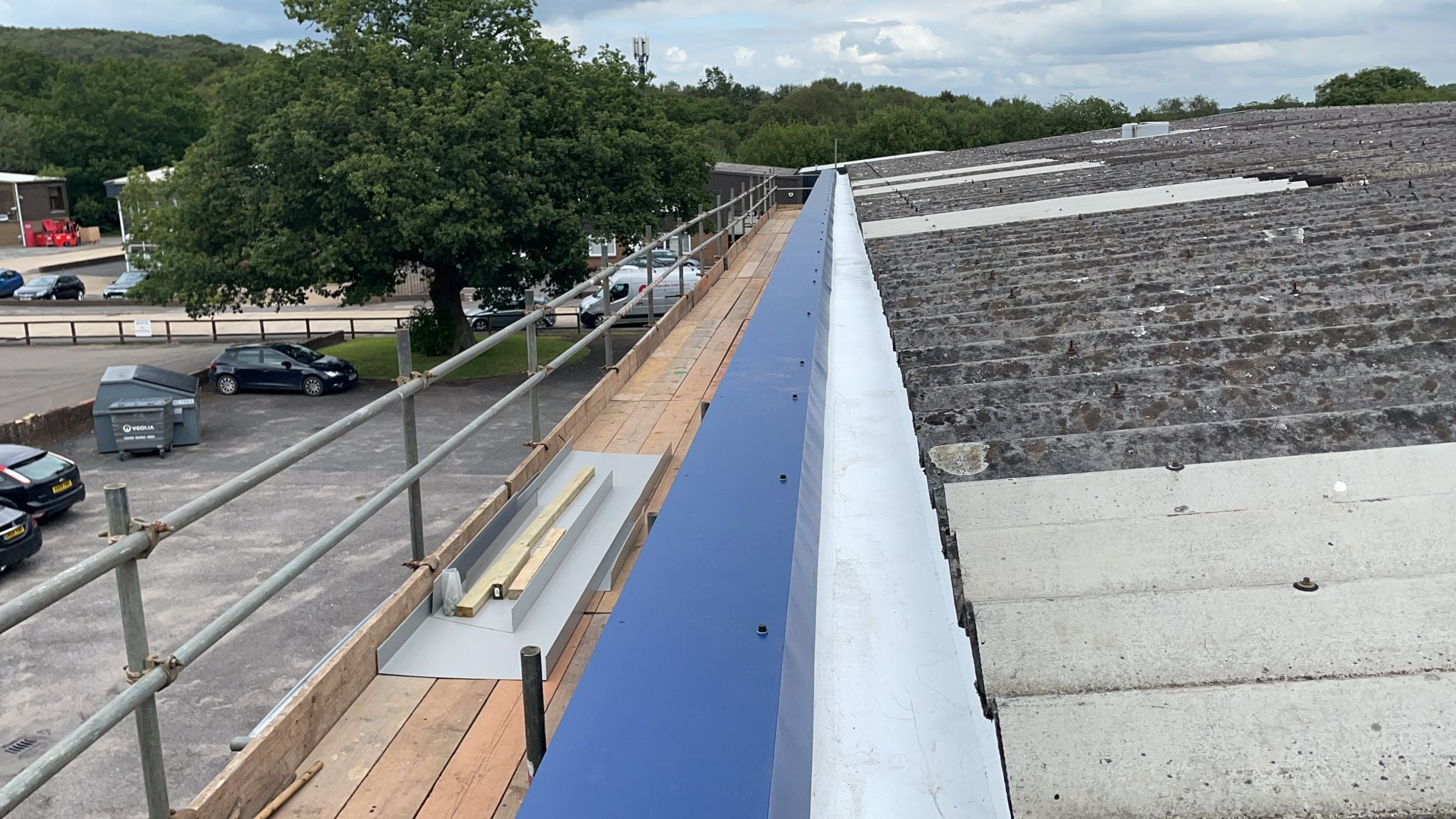 Guttering to a warehouse and office roof in Crowborough East Sussex