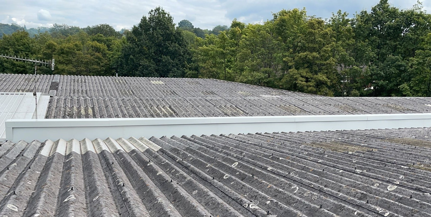 Leaking gutter on a warehouse and office roof in Crowborough East Sussex