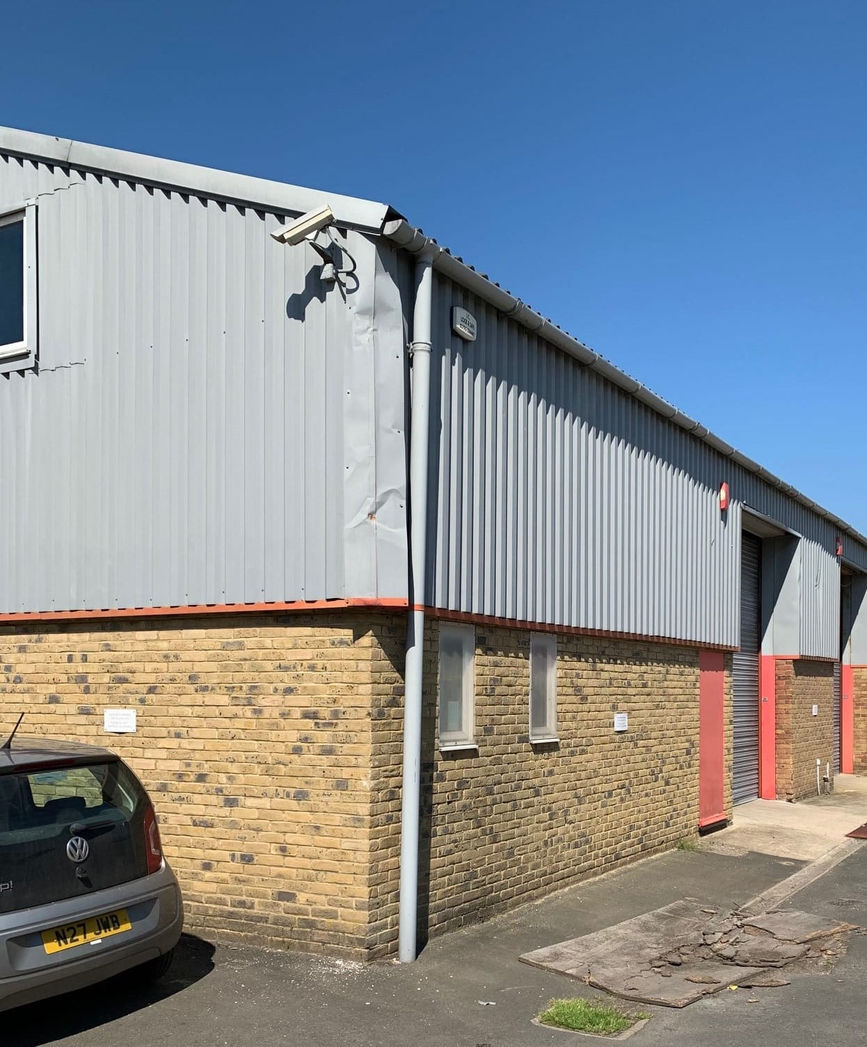 Repairs to cladding on an industrial building in Faversham Kent