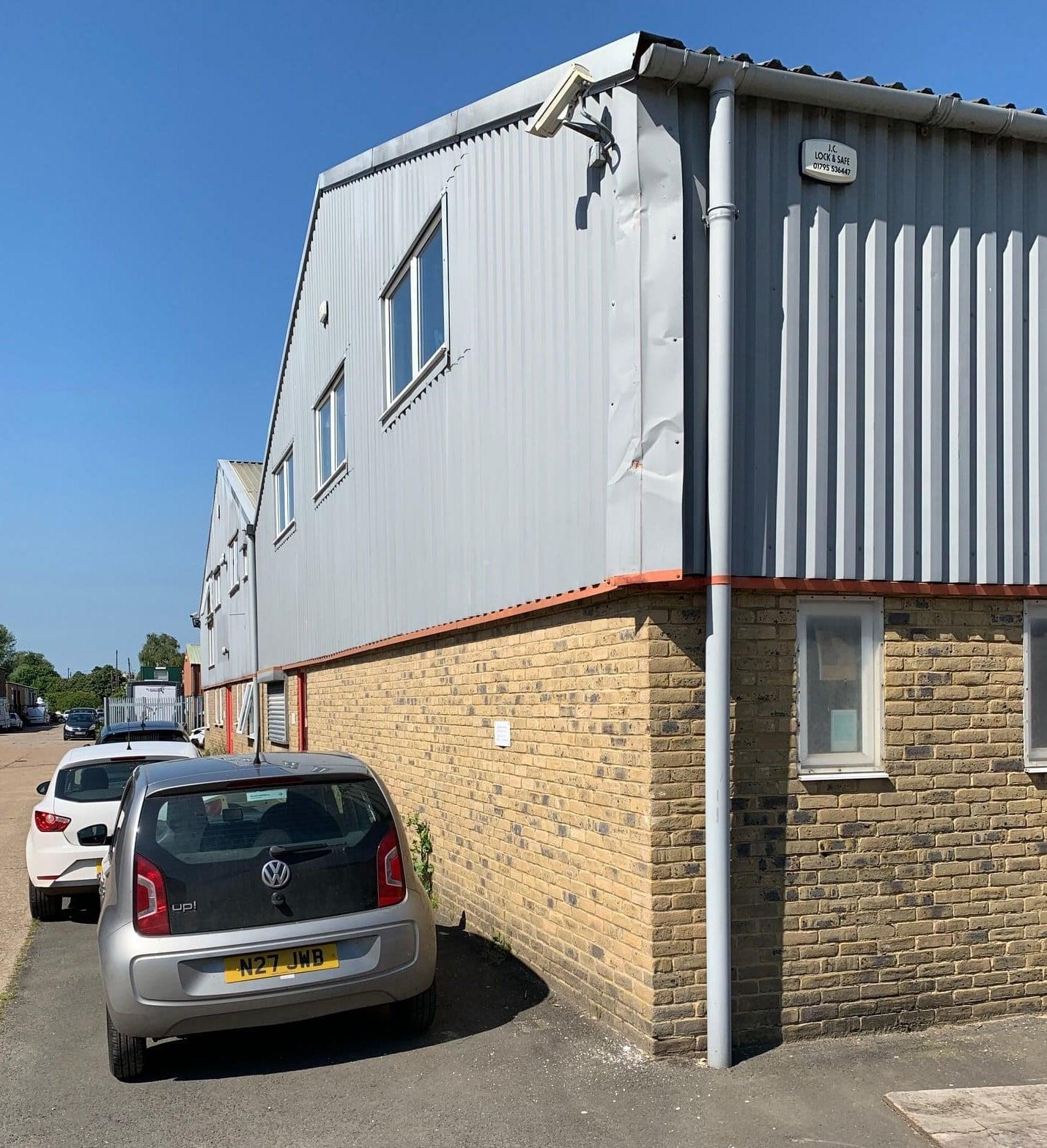 cladding repair damage on an industrial building in Faversham Kent