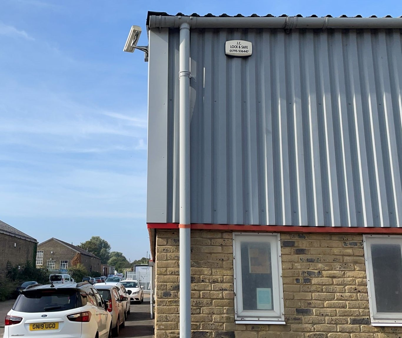 repairs to damaged cladding flashings on an industrial building in Faversham Kent