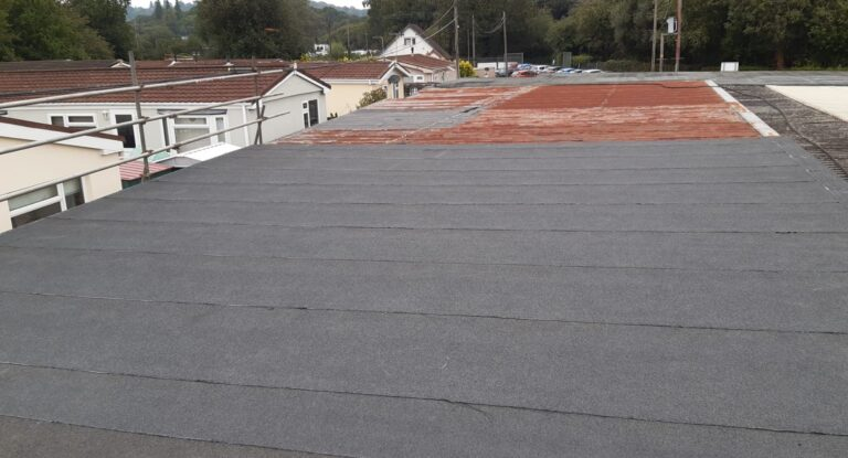 Felting contract on the office roof of a company in Redhill Surrey
